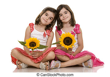 pretty brunettes twins sitting on white isolated background