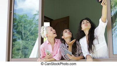 Girls Use Cell Smart Phones Talking Take Selfie Photo ...