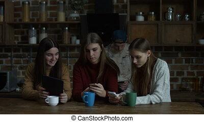 Girls using modern technologies for communication