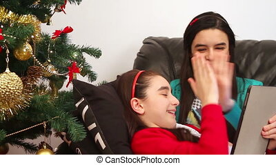 Girls using tablet pc on Christmas