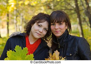 girls walking in autumn