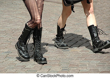 Girls walking in boots