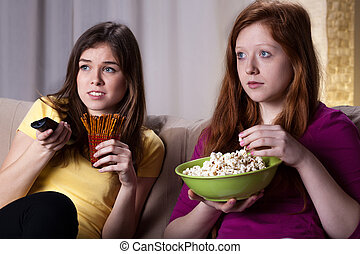 Girls watchiong horror movie - Young girls friends watching...
