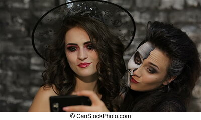Girls-witch and skeleton make selfie