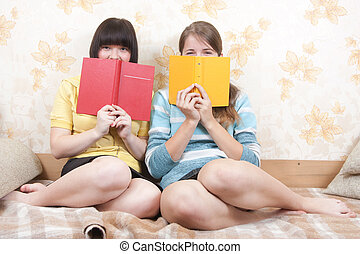 Girls with books indoor