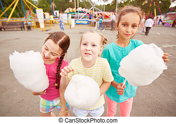 Girls with cotton candy - Cute girls eating cotton candy...