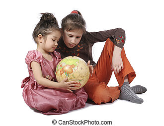 Girls with globe - Two girls consider globe on white ...