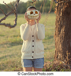Girls with pumpkin face