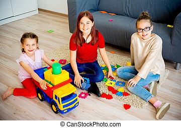 Girls with toy truck