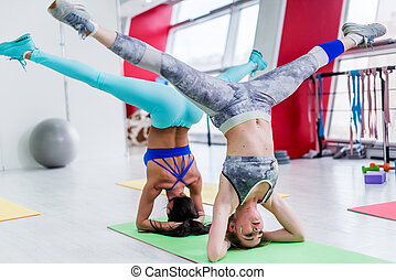 advanced yoga pose young woman in difficult contorted