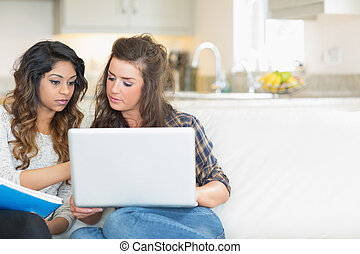 Girls working with laptop