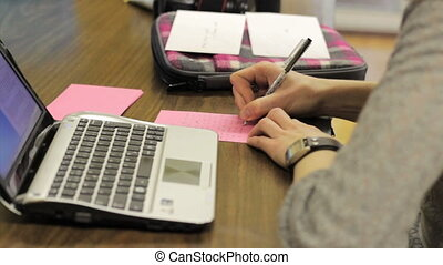 Girls Writing Thank You Cards - Two female young adults...