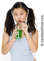 Girly Drink - A teenage women drinking a green drink