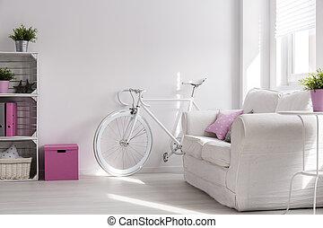 Girly interior with white, stylish bike