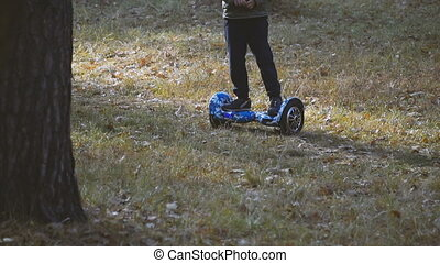 Giroboard. The child rides a gyroboard in the park