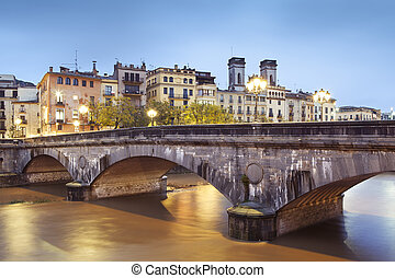 """View of the historic """"Pont de Pedra"""" that means Stone Bridge. Builded in 1866, Girona."""