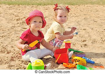 girs in sand