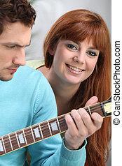 gitaar, snotneus, spelend
