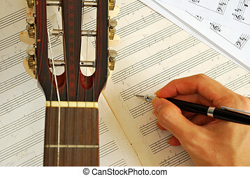 gitarr, med, hand, skriv, musik, på, manuskript
