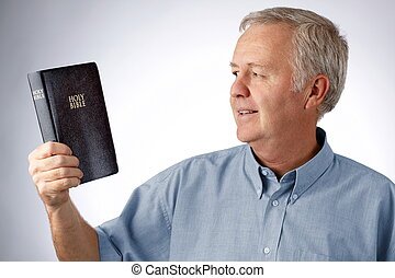 Give light to my eyes, Lord... - Man looking to the Bible in...