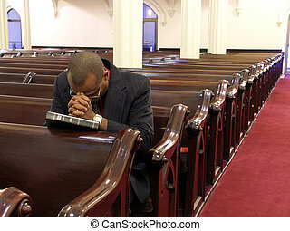 Give me strength - African-American man praying alone.