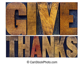 give thanks - Thanksgiving concept - isolated word abstract in letterpress wood type with ink patina