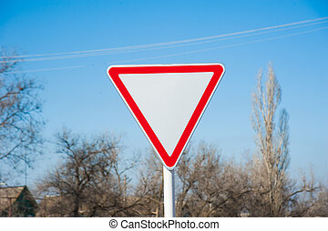 Give Way Road sign with blurred background