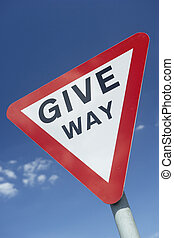 Give Way Sign Against A Blue Sky