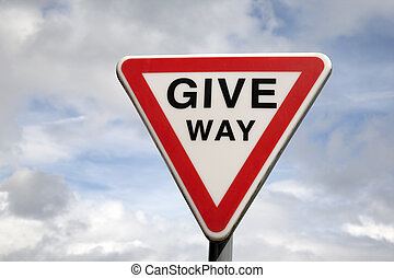 Give Way Sign against blue sky background