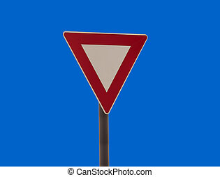 give way traffic sign isolated on blue sky