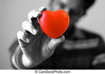 Give You My Heart (bw) - A young man giving is red hear with...