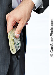 Giving a Bribe - Giving a bribe into a pocket, vertical...