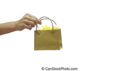 Giving Away a Small Yellow Gift Bag