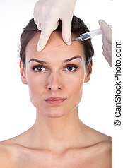 Giving botox injection in female skin - Plastic surgeon...