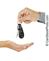 Male hand giving car key to female hand