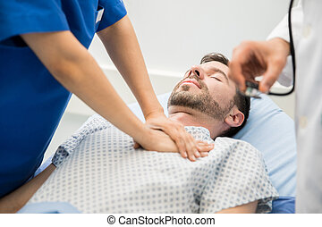 Giving cardiac massage to a patient