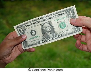 giving dollar to kids hand