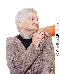 Giving help - A woman hand touching an elderly shoulder
