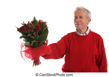 Giving her flowers - Senior man holding out a bouquet of ...