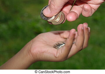 giving coins to kid