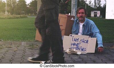 Giving money to homeless beggar