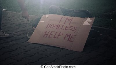 Giving money to homeless beggar - People giving money to...