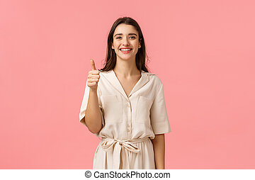 Giving positive feedback, recommendation. Good-looking cheerful, tender girl in gorgeous dress, showing thumb-up in approval, satisfied or advertising gesture, smiling like product, pink background