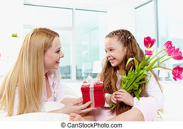 Giving presents - Adorable girl with bunch of beautiful...