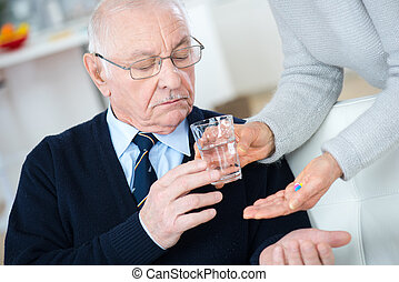 giving the prescribed tablets