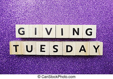 Giving Tuesday alphabet letter on purple glitter background