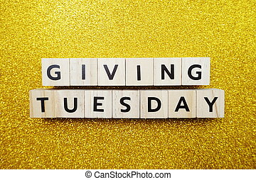 Giving Tuesday alphabet letter on yellow glitter background
