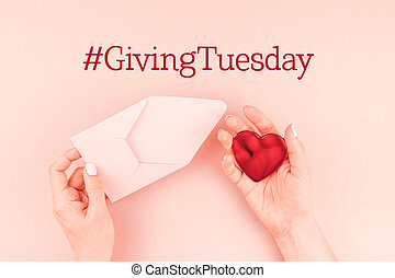 Giving Tuesday concept with red heart in hand - Giving ...
