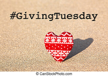 Giving Tuesday concept with red knitted heart - Giving ...