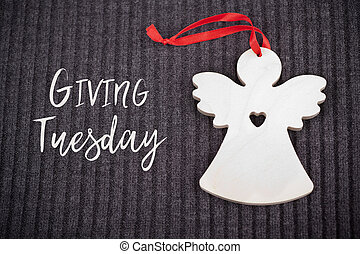 Giving Tuesday concept with Wooden Angel - Giving Tuesday is...